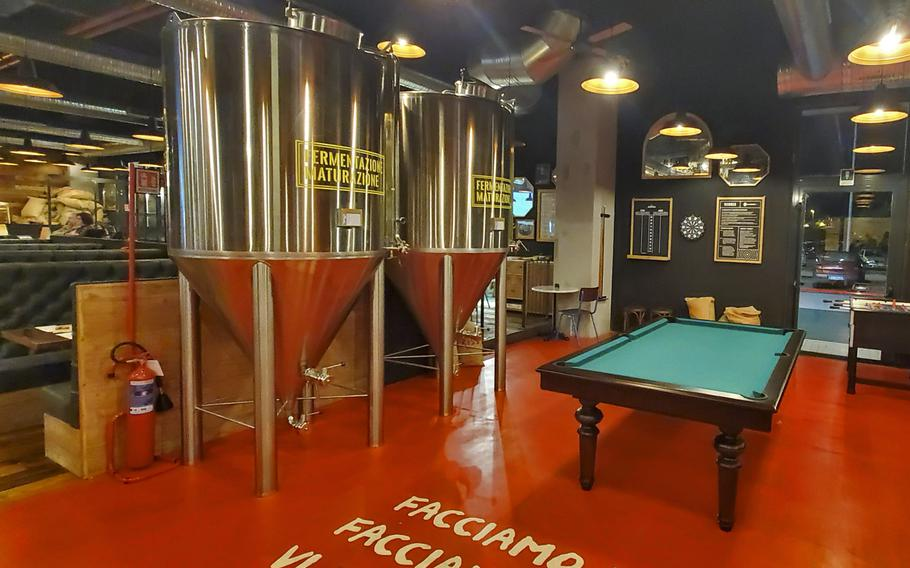 Doppio Malto's fermentation containers inside their new location adjacent to the Granfiume Gran Shopping mall in Fiume Veneto, Italy. Doppio Malto's award-winning craft beers are just one reason to stop by this restaurant and brewery.