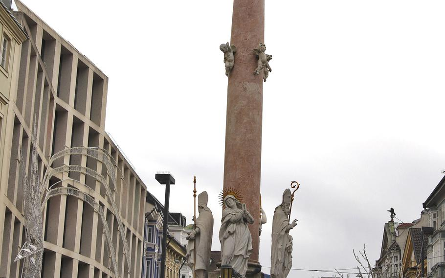 St. Anne's Column, located in Innsbruck's city center, is made of red marble and topped by a statue of the Virgin Mary.