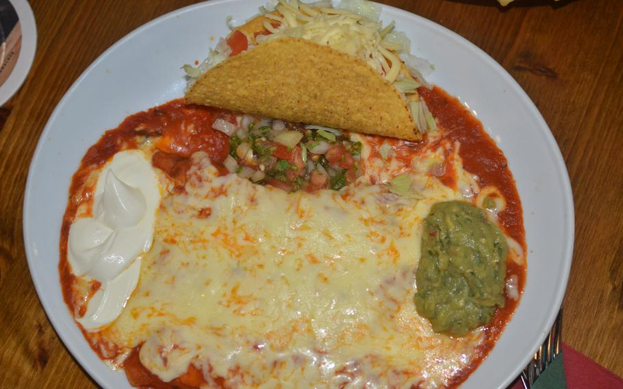 The El Patron plate at Hacienda Mexican Restaurant is three beef enchiladas smothered in cheese and a beef taco, with sour cream, guacamole and pico de gallo.