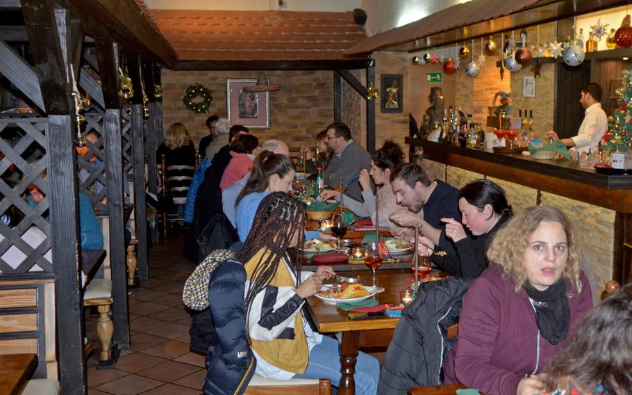 The Hacienda Mexican Restaurant in Wiesbaden, Germany offers table service with a bar.