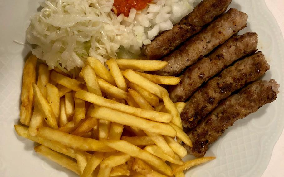 A plate of cevapcici, a favorite in several countries in southeast Europe, in Kaiserslautern's Balkan Grill restaurant.