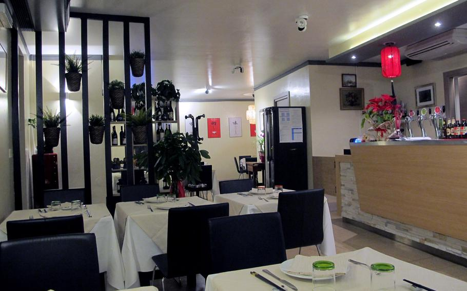 The dining room at Cicchetteria Cinese Zhu in Vicenza is done in classic black, white and red. The service is helpful and friendly.