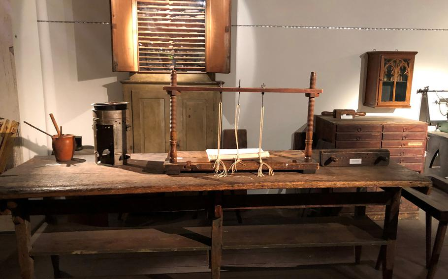 A replica of a book binding station from Johannes Gutenberg's era is on display.