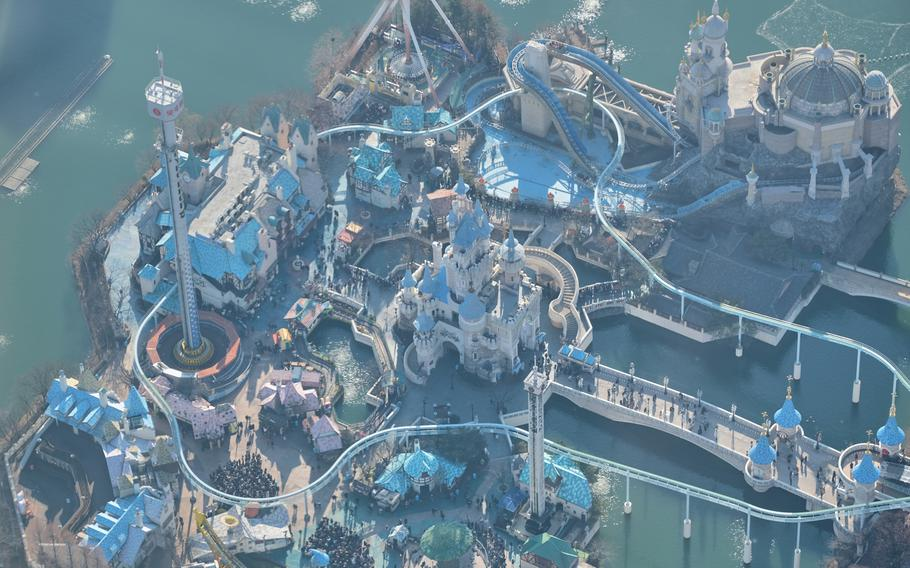 The Lotte World theme park looks like a child's playset from Lotte World Tower's Seoul Sky observation deck in Seoul, South Korea.
