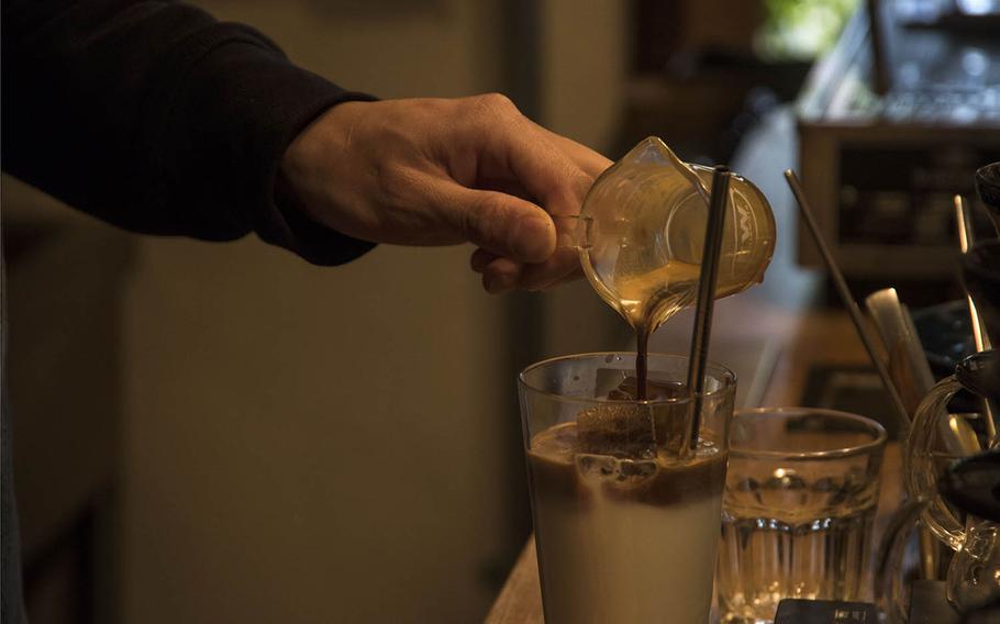 The barista at Cafe D-13 near Yokota Air Base, Japan, mixes a double shot of espresso into milk, making a latte on Jan. 22, 2020.