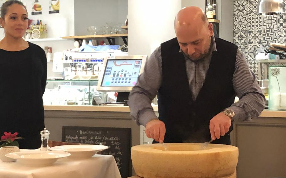 Homemade pasta is mixed in a wheel of parmesan, one of the specialties of the Italiano Sapori Veri restaurant in Kaiserslautern, Germany.