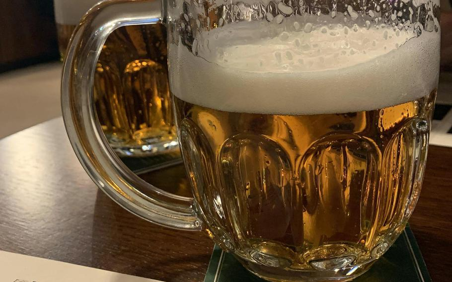 A half-liter of draft Pilsner Urquell beer is a good start to a meal in the Na Spilce restaurant in Pilsen, Czech Republic. The first blonde, clear pils beer was brewed in this town in 1842.