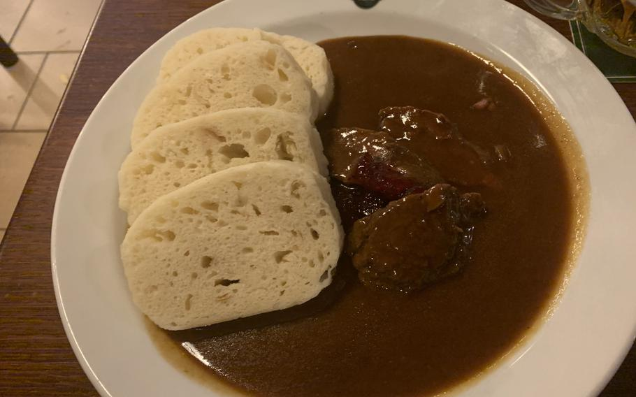 A traditional Czech dish of wild boar with rosehip sauce and bread dumplings was a filling main course at Na Spilce restaurant, in the Pilsner Urquell brewery's old fermentation room.
