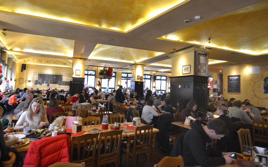 The lunch crowd dines at Nuremberg's Roeslein on Dec. 21, 2019. Roeslein bills itself as the largest bratwurst restaurant in the world.