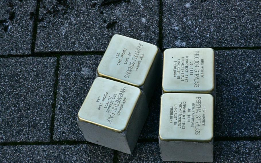Four of the Stolpersteine that were laid outside a business on Eisenbahnstrasse in Kaiserslautern, Germany on Wednesday, February 5, 2020 in memory of the Strauss family. The parents, Theodor and Bertha, were deported to Theresienstadt in what is now the Czech Republic and later murdered in Treblinka in Poland, but their children managed to flee to the U.S. and survived the Holocaust.