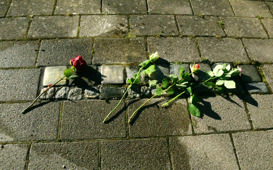 A red rose lies on the Stolperstein laid in Philipp-Mees-Platz in Kaiserslautern, Germany on Wednesday, February 5, 2020, in memory of Jonathan Volk, a political opponent of the Nazi regime.