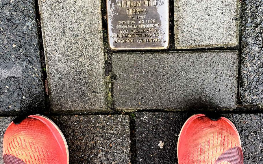 The Stolperstein on Laendelstrasse in Kaiserslautern, Germany, for Wilhelm Otto Dinges, who was conscripted into Nazi Germany's forced labor program when he was 17 and out of work. Dinges died at the age of 21 in the Buchenwald concentration camp.