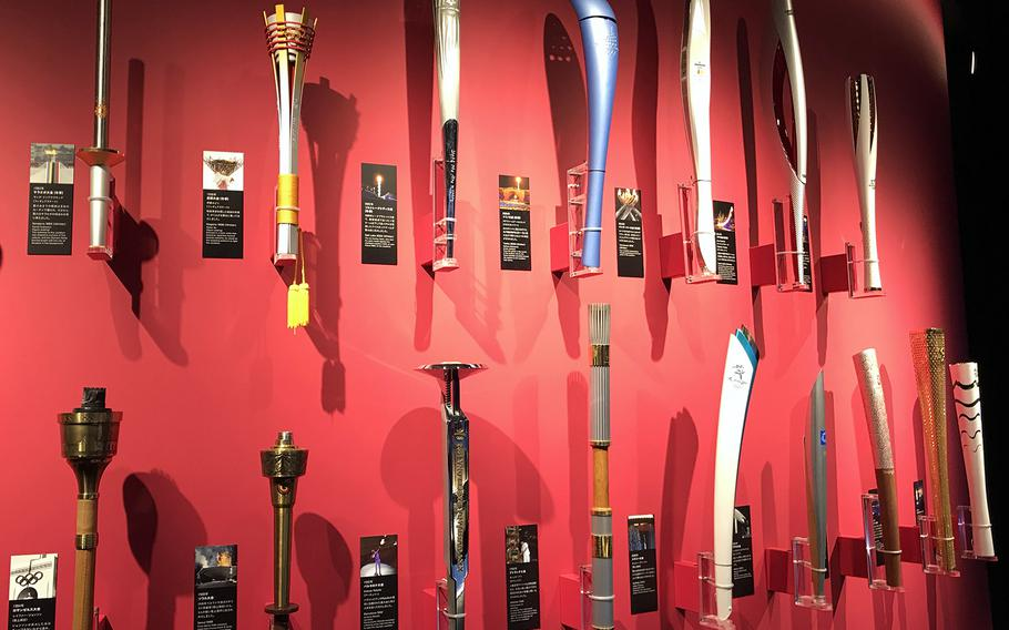Torches used during past Summer and Winter Games are dispayed at the Japan Olympic Museum in Tokyo, Jan. 22, 2020.