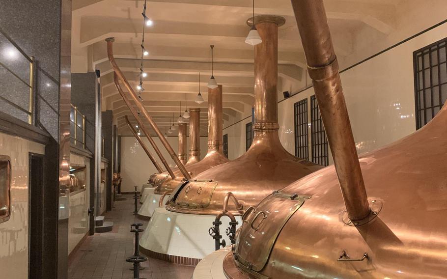 Copper kettles inside the Pilsner Urquell brewery in Pilsen, Czech Republic.