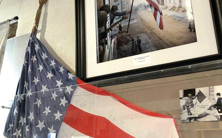 The actual U.S. flag that was hoisted on city hall in Bitche, France, during the liberation of the town by the 100th Infantry Division. Above it is the photo of the event in 1945. The liberating troops instantly became known as the ''Sons of Bitche.''