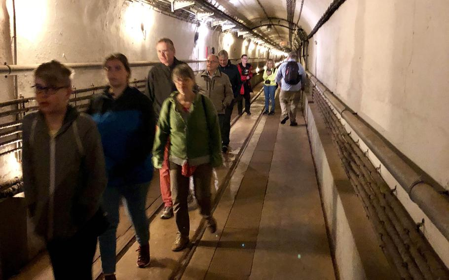 Visitors file through the long underground galleries at the Simserhof fortress on the Maginot Line. The fortress is located about 60 miles from the Kaiserslautern/Ramstein area.