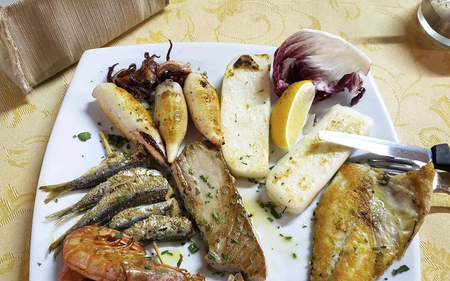 A seafood platter from a local restaurant in Grado, Italy. Most restaurant menus in the island town are dominated by seafood dishes, but they also offer items for people who can't or don't want to eat seafood.
