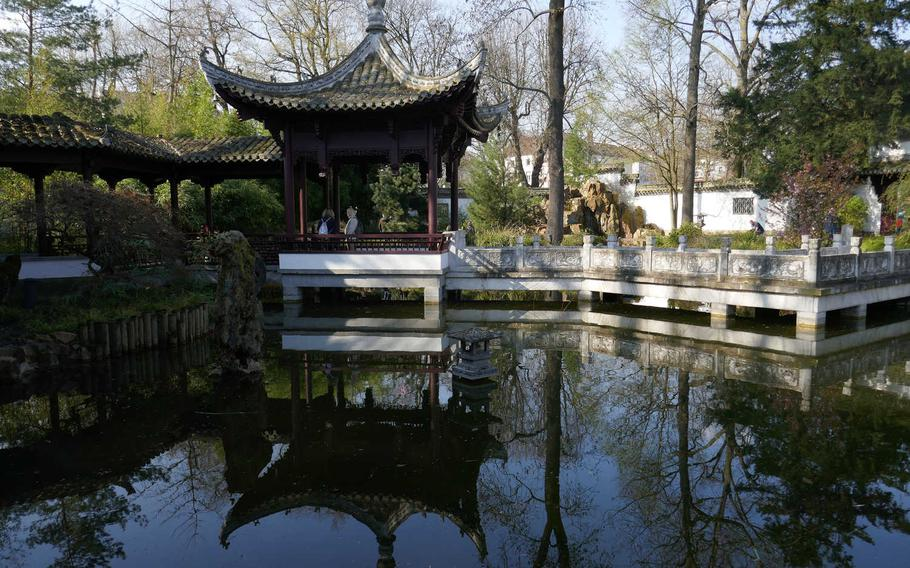 The Chinese Garden inside the Bethmannpark in Frankfurt am Main, Germany. The park is across the busy Friedberger Anlage street from the Wallanlagen, a greenbelt of parks surrounding the center of Frankfurt, north of the Main River, where the city's defensive walls once stood.