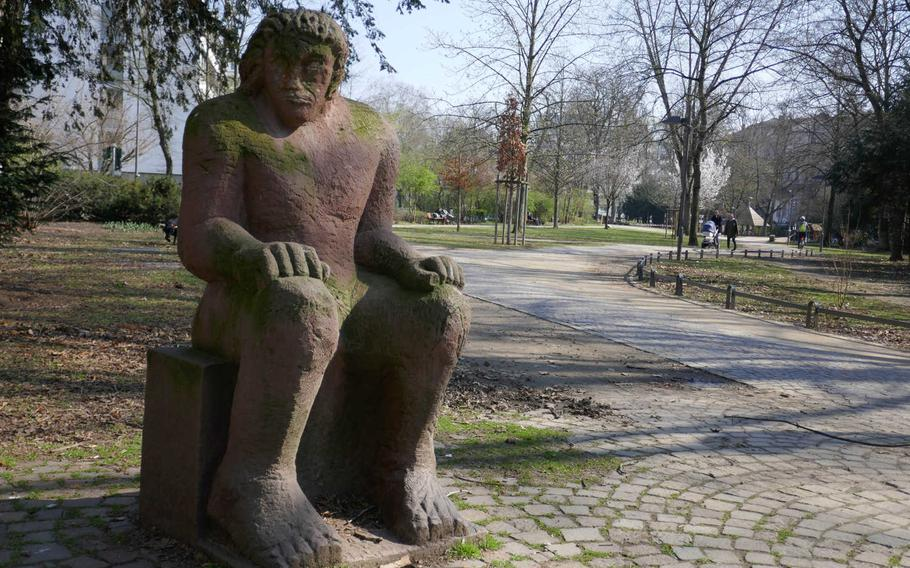 Statues of famous people or works of art like this one, by Michael Siebel, dot the Wallanlagen in Frankfurt am Main, Germany. The Wallanlagen is a greenbelt of parks surrounding the center of Frankfurt, north of the Main River, where the city's defensive walls once stood.