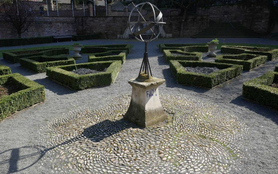 A sundial stands in the middle of the Buergergarten, a small park in the Eschenheimer Anlage in Frankfurt am Main, Germany. Below street level, the park is a quiet oasis in the busy city.