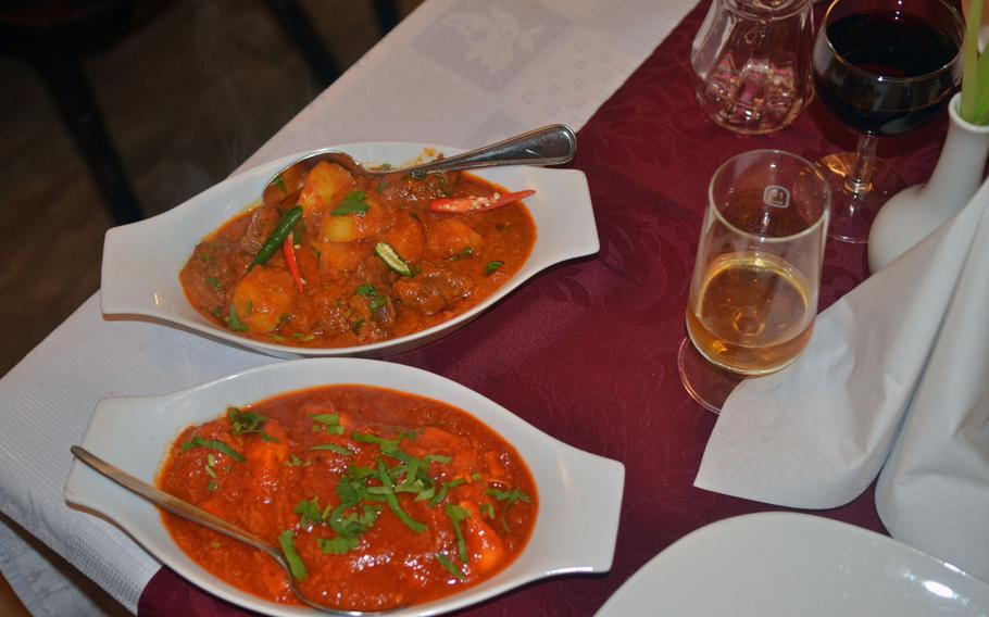 Indian Palace's chicken makhni, includes sliced chicken breast fried in butter and served in a mild tomato-based curry. Lamb karahi, top, has lamb pieces cooked with ginger and herbs, made in a karahi pan.