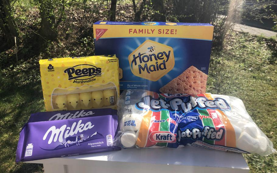 The ingredients are assembled for a snacking experiment during the coronavirus quarantine: s'mores with Milka bars and Peeps alongside the traditional marshmallows and graham crackers.