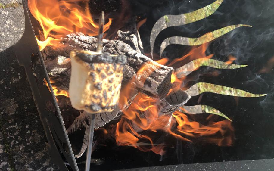 A marshmallow is overcooked over an open flame as part of a s'mores experiment. Conventional marshmallows turned out to be superior to Peeps in the snack.