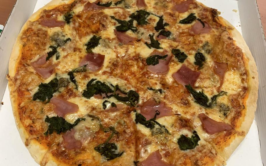 Da Peppino's medium pizza, featuring spinach and ham. The flavor and presentation made it a satisfying meal from the restaurant, which has been operating in Grafenwoehr, Germany since 2009.