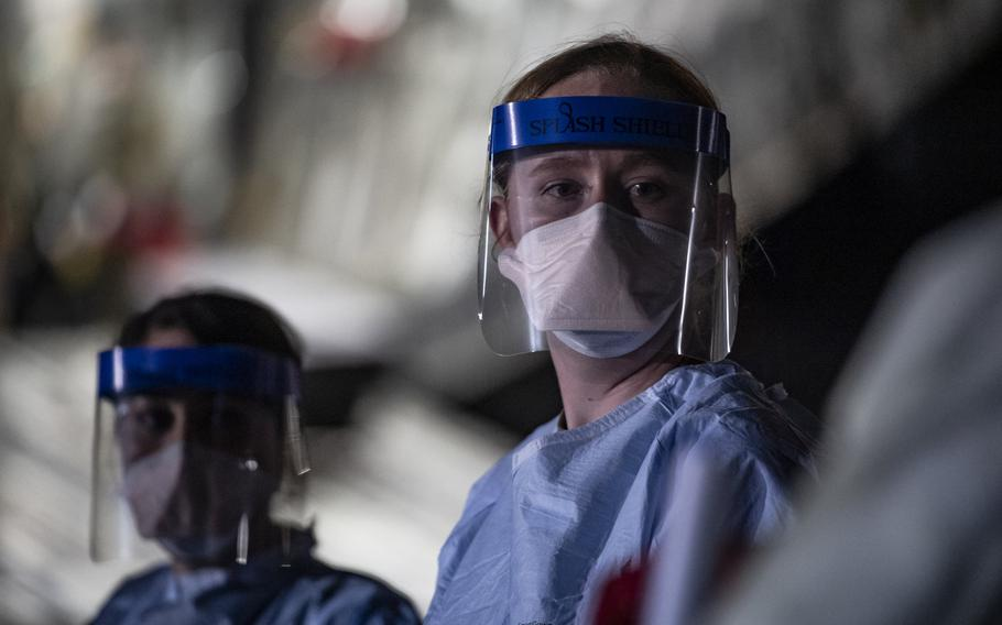 A  medical airman awaits transport documentation at Ramstein Air Base, Germany, April 10, 2020 following the first-ever operational use of the Transport Isolation System. Three patients with coronavirus were evacuated from Afghanistan to Ramstein in the TIS, which was designed in 2014 to transport Ebola patients.