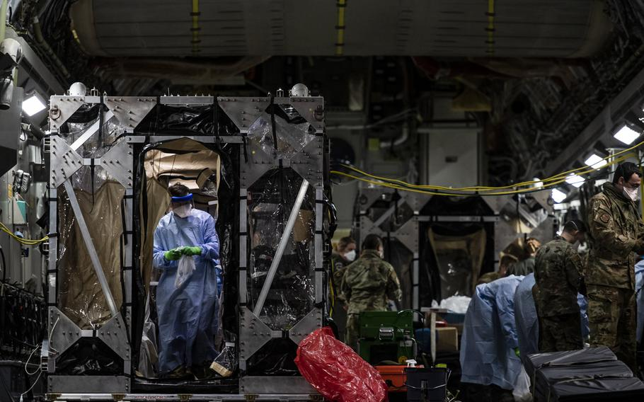 U.S. Air Force airmen aboard a C-17 Globemaster III aircraft begin disinfecting and decontaminating the aircraft after the first-ever operational use of the Transport Isolation System at Ramstein Air Base, Germany, April 10, 2020. The TIS is an infectious disease containment unit designed to evacuate patients with an infectious disease, in this case COVID-19.