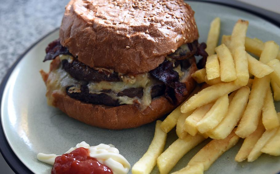 A Burtonburger from Neil's Pub in Mackenbach, Germany, available for takeout, can satisfy a hearty appetite with its two beef patties and generous toppings.