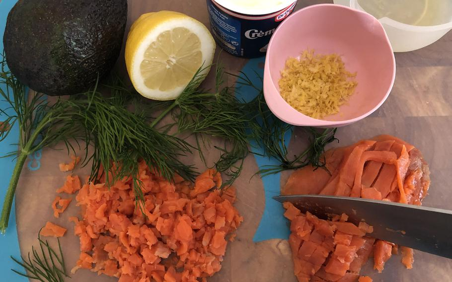 The ingredients for smoked salmon tartare: smoked salmon, avocado, creme fraiche, lemon zest and juice, and dill.