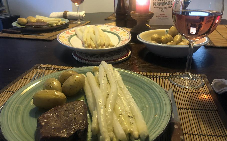 A wedding anniversary dinner of asparagus with a melted butter sauce, boiled new potatoes and beef filet.