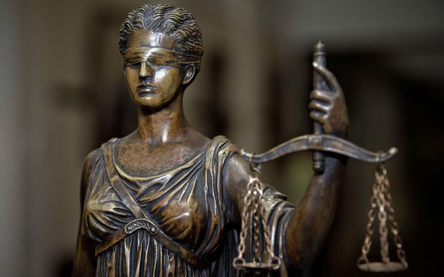 A statue of Lady Justice at the Air Force Judge Advocate General's School at Maxwell Air Force Base, Ala. The Air Force???s top lawyer says the service needs to reform its judicial system to address racial inequities.