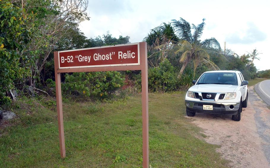A sign on Perimeter Road near Tarague Beach at Andersen Air Force Base, Guam, marks the resting place of the tail section of a B-52E Stratofortress.