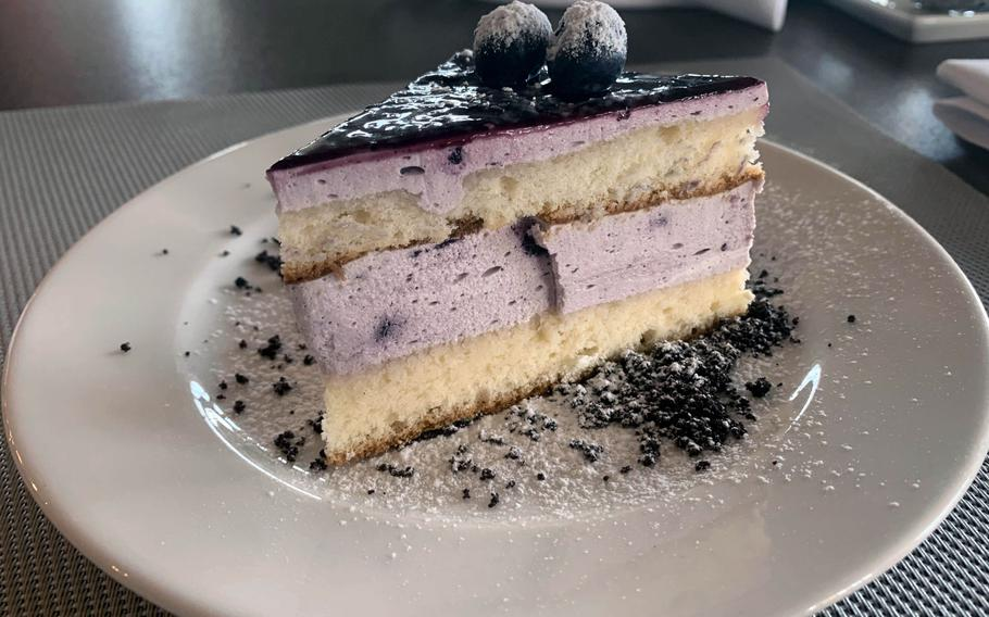 A slice of black raspberry cake is a tasty dessert option at the Yachtova restaurant in Mikolajki, Poland.