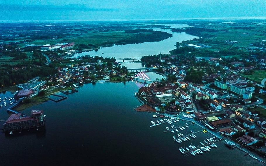 An aerial shot, taken with a drone, of the town of Mikolajki, Poland, in the country's northeastern lake district. Lake Mikolajskie is in the foreground and Yachtova restaurant is at the bottom left of the picture.