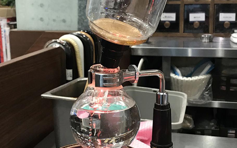 Kurashiki Coffee in Sasebo, Japan, uses a single-serve siphon brewer for its signature cup of joe.