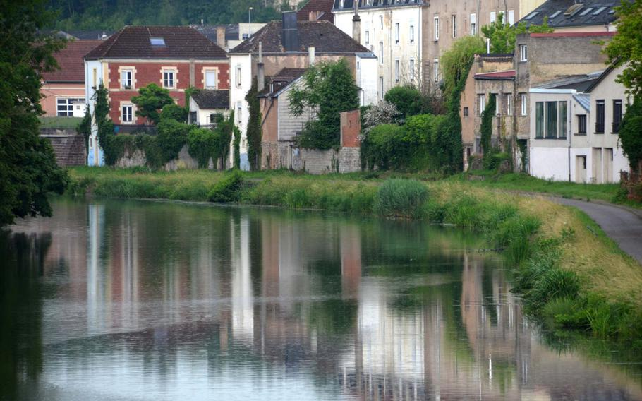 Houses in Sarreguemines, France, reflect in the Saar River on Weds., June 17, 2020. Sarreguemines is at the western end of the 80-mile Glan-Blies bike path, on the right in the picture, which runs from Staudernheim, north of Kaiserslautern, Germany, to Sarreguemines.