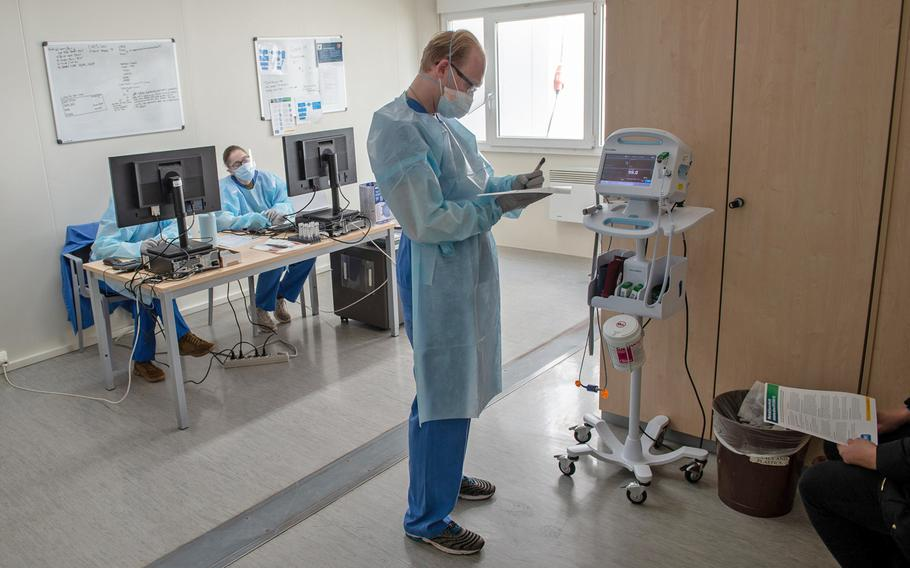 Medical technician Spc. Thomas Ashworth watches a monitor as a patient is screened for coronavirus at Landstuhl Regional Medical Center in Germany, in March 2020. Most of the small number of active-duty soldiers who are seriously sickened with COVID-19 had underlying medical conditions such as obesity and high blood pressure, a study has found.