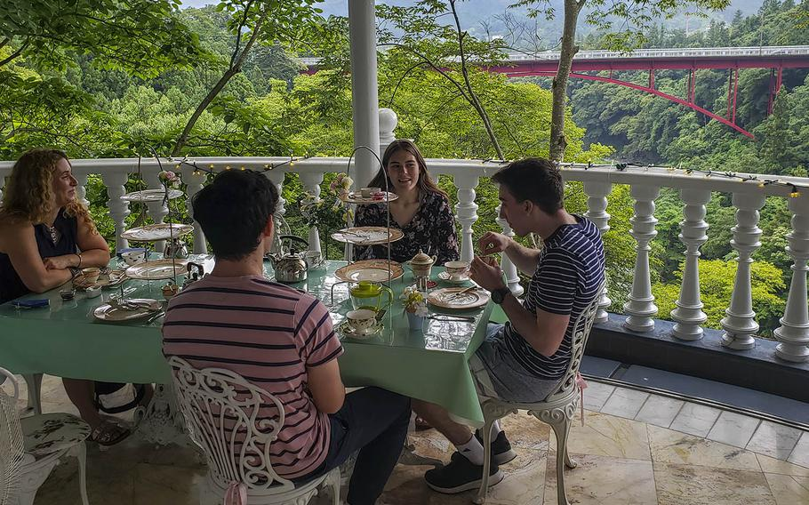 Visitors from Yokota Air Base in western Tokyo enjoy tea time at the naearby Rose Town Tea Garden in Ome, Japan, June 24, 2020.