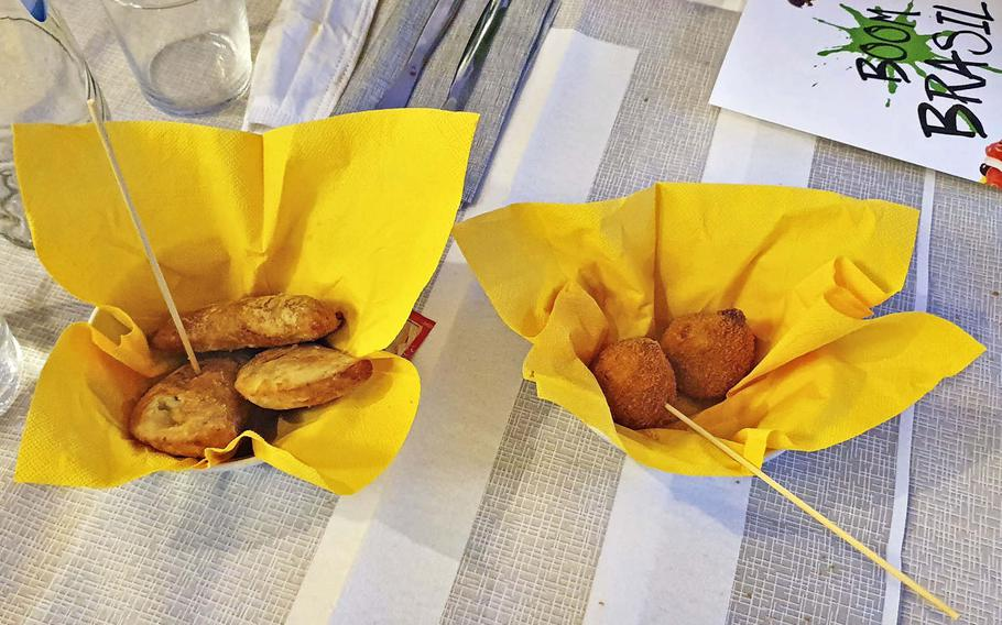 Appetizers at Boom Brasil, a recently opened restaurant in Sacile, Italy. On the left, pastelzinho di carne, which are a type of meat-filled empanadas, and on the right, coxinha de frango, which are fried, shredded chicken-filled dumplings.