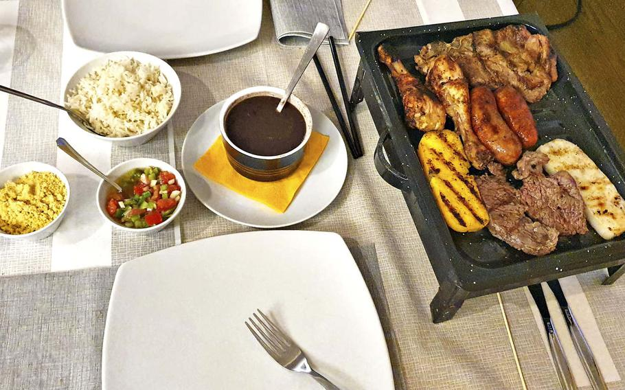 Boom Brasil's gran grigliata mista, which is a large mixed grill dish containing beef, a pork chop, two types of sausages, chicken drumsticks and fried polenta. The restaurant opened at the beginning of June and is located about 11 miles from Aviano Air Base.