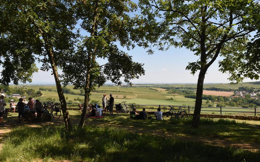 Hikers rest and enjoy the panaromic view at the ''wine rest with a view'' in Moelsheim, a quaint wine village along the Zellertalweg trail in Rheinland-Pfalz, Germany.