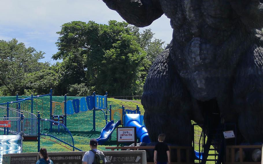 A large Godzilla statue is popular with children of all ages at Kurihama Flower World in Yokosuka, Japan.
