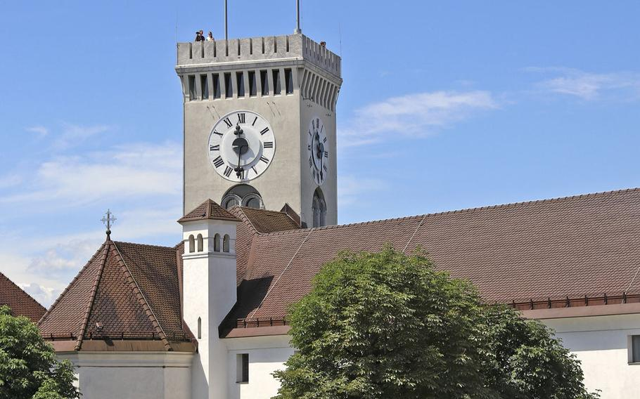 View of the clock tower at Ljubljana Castle in Slovenia's capital city, Ljubljana. The castle can be reached by funicular railway, and offers some of the best views of the city, particularly from the clock tower.