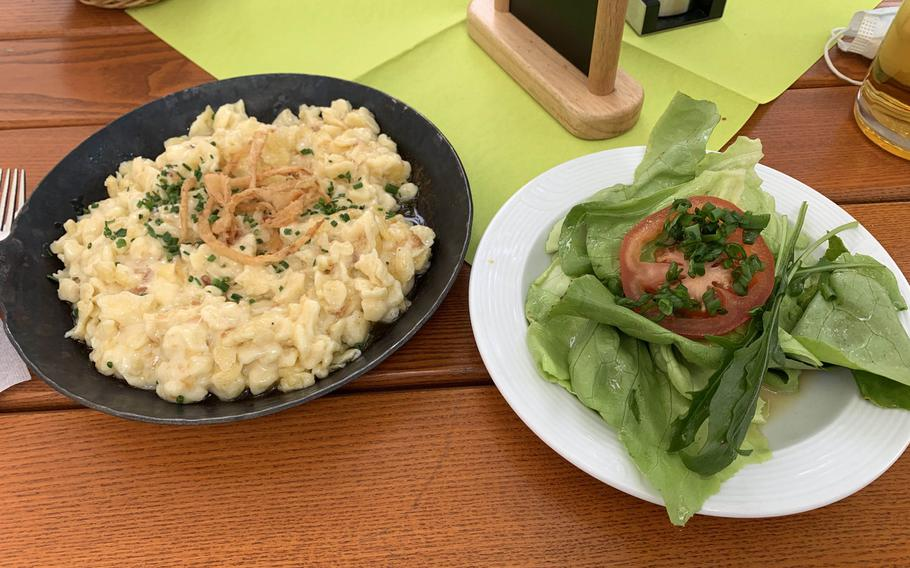The spaetzle with cheese and onions served with a salad at the restaurant Zum Stich'n in Grafenwoehr, Germany on May 22, 2020.