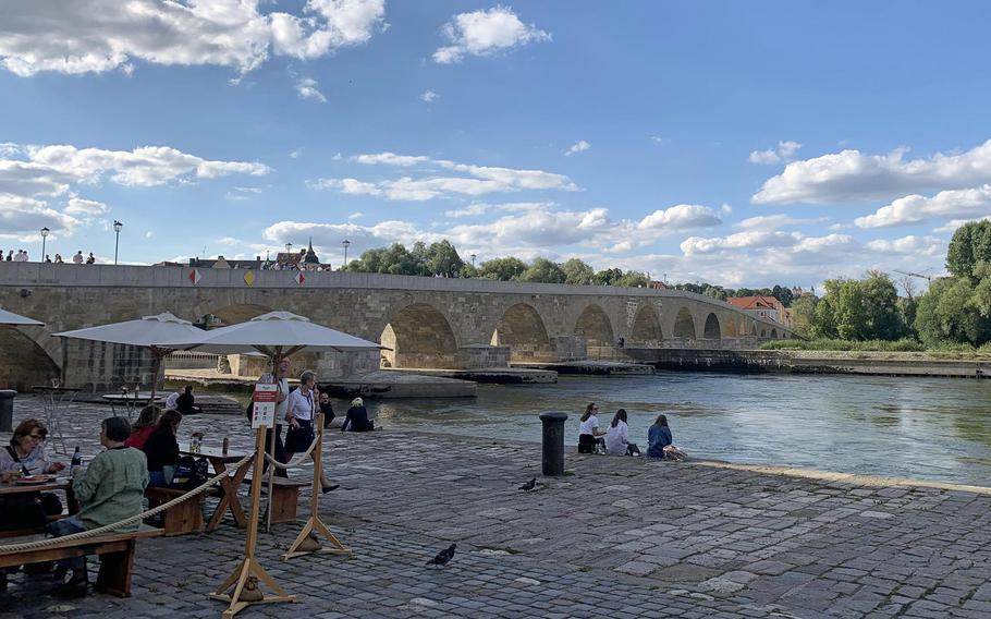 The historic Steinerne Bruecke, or Stone Bridge, in Regensburg, Germany, July 7, 2020. The bridge, which dates back to the 12th century, provides tranquil views of much of the city.
