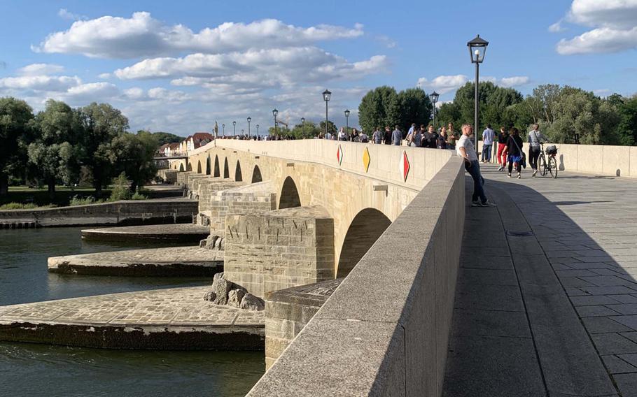 The historic Stone Bridge over the Danube River in Regensburg, Germany on July 7, 2020.