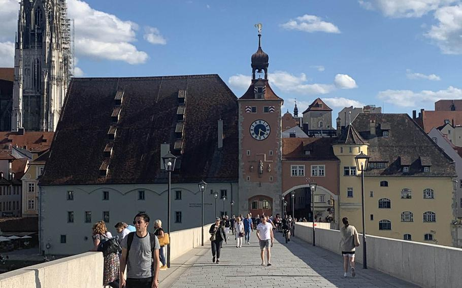 The historic Steinerne Bruecke, or Stone Bridge, in Regensburg, Germany on July 7, 2020. St. Peter's Cathedral, another city attraction, is in the background at left.